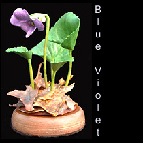 leather sculpture of violet flower