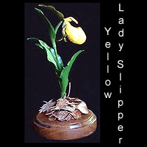 leather sculpture of yellow lady slipper orchid flower